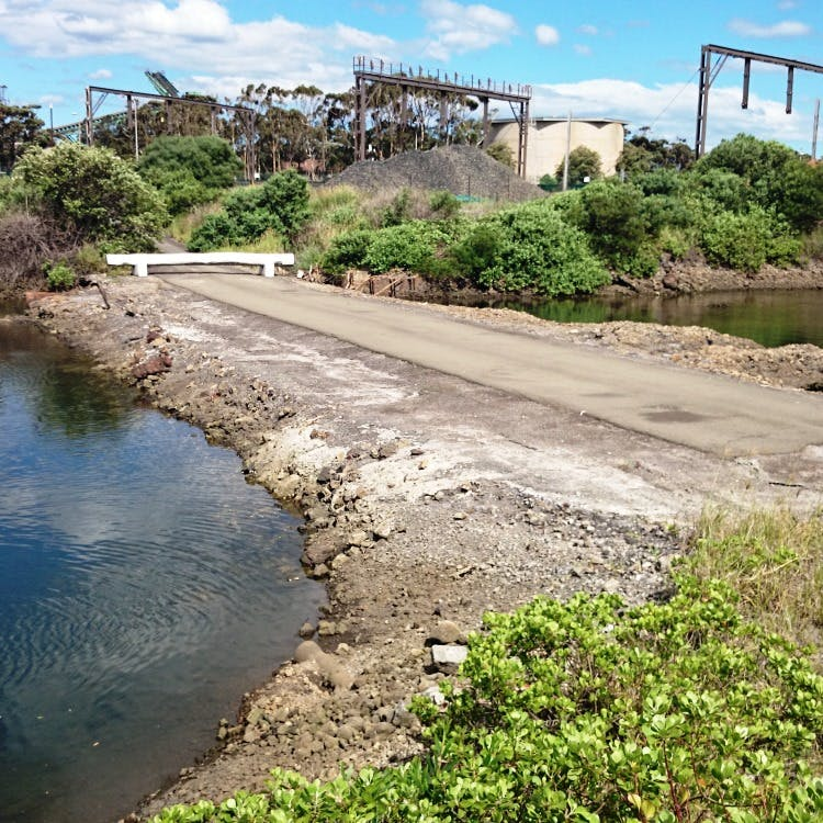 A picture of the concrete road causeway across Guranguty waterway, Wollongong