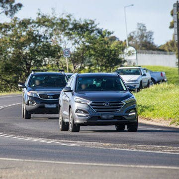 Cars travelling on barwon heads road
