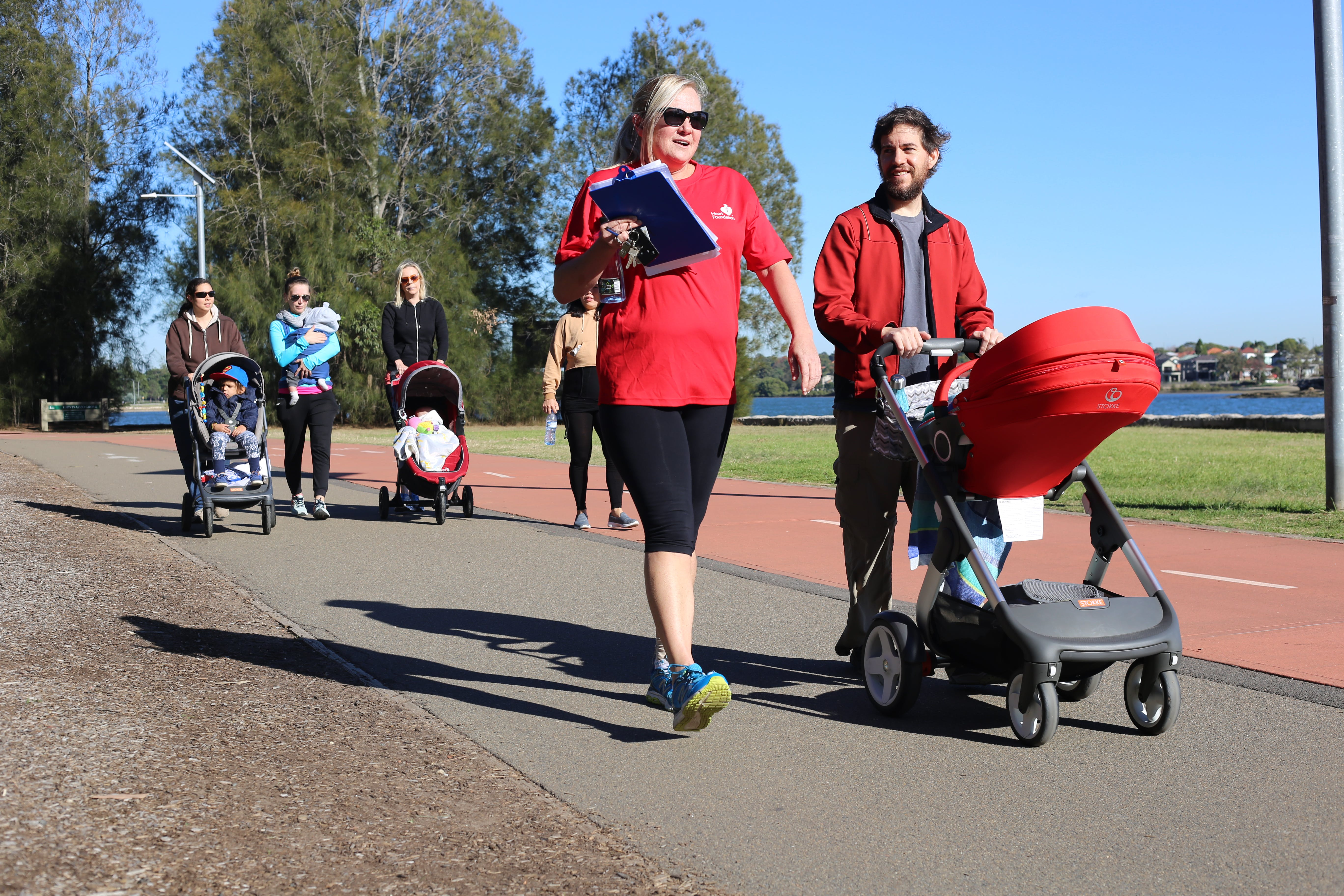 Parents with prams walking in Leichhardt Park