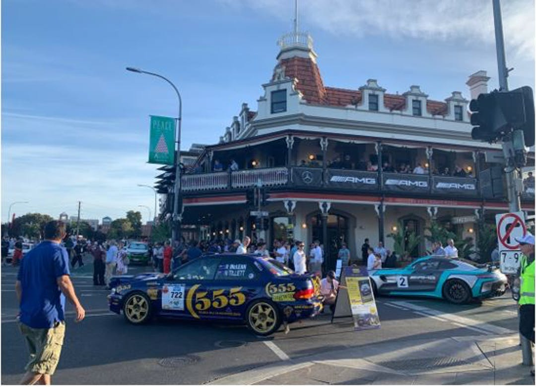 Bottom of Rundle Street. Stag Hotel visible in the background. In the foreground you can rally cars parked for viewing.
