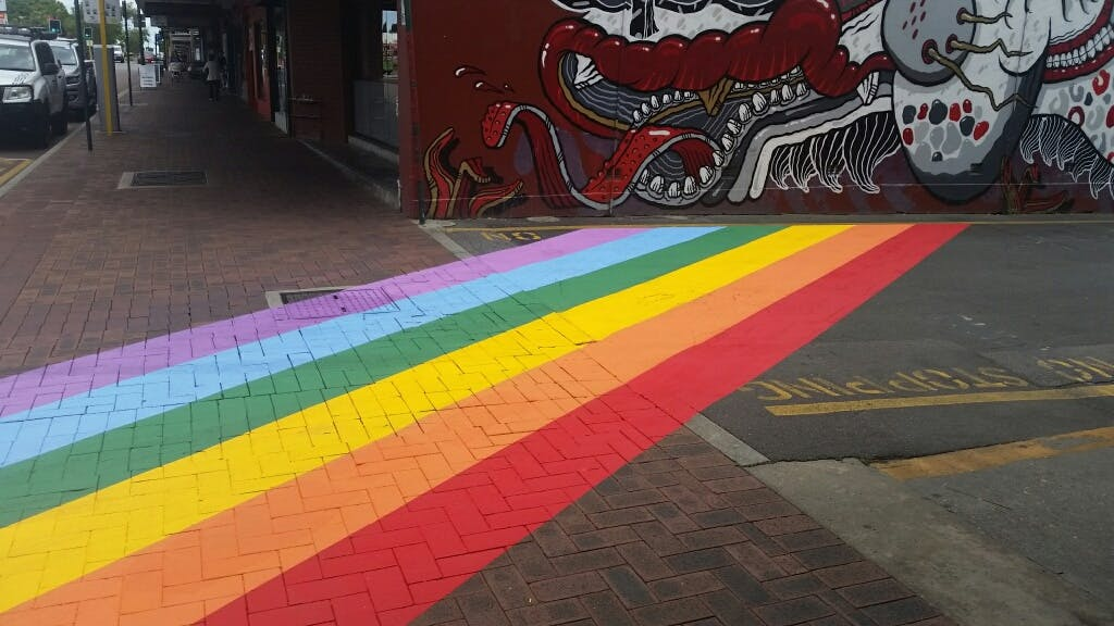 IGA Laneway painted in rainbow colours