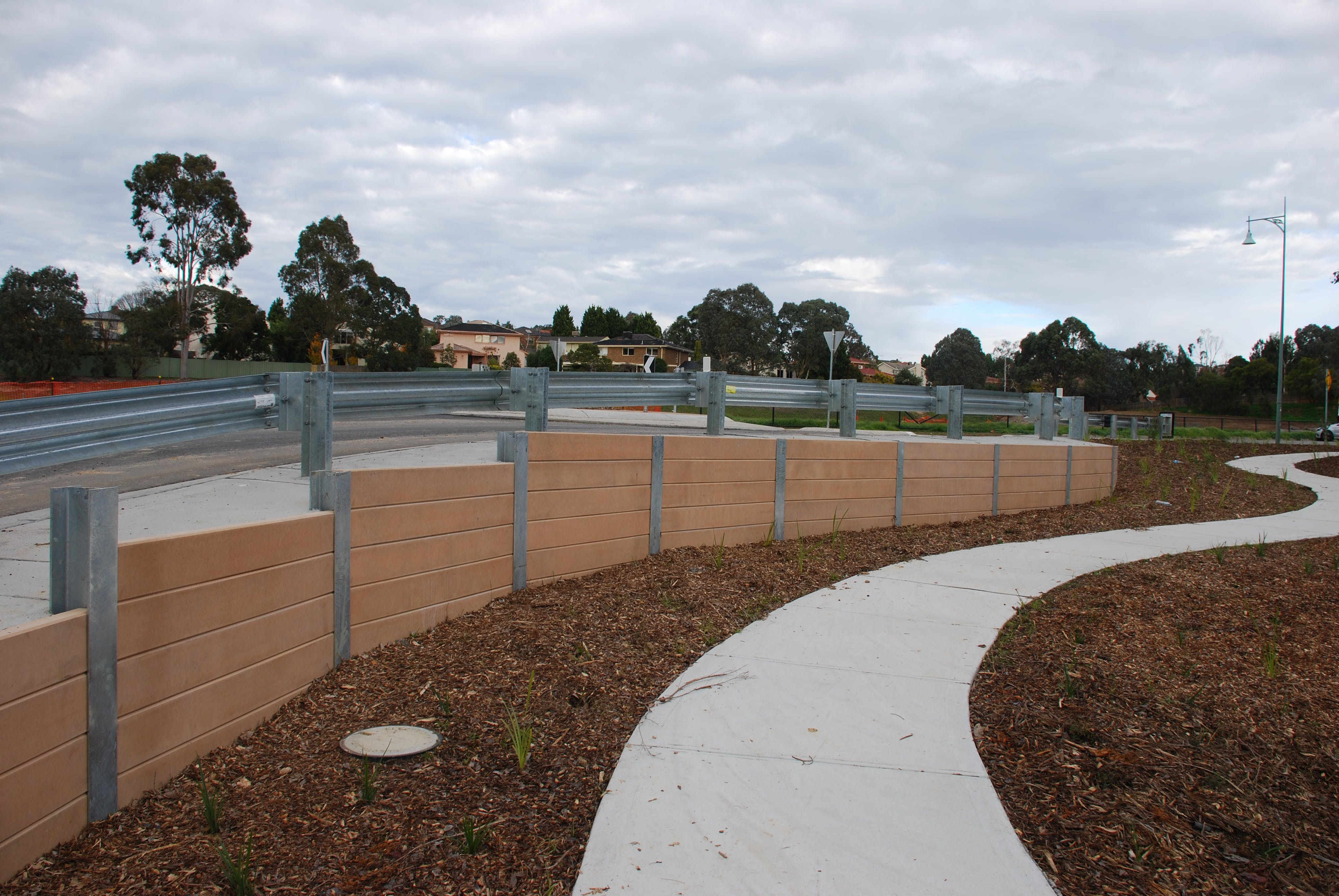 New Footpaths And Retaining Wall