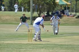 Cricket on a sportsground. A 'non contact' sport