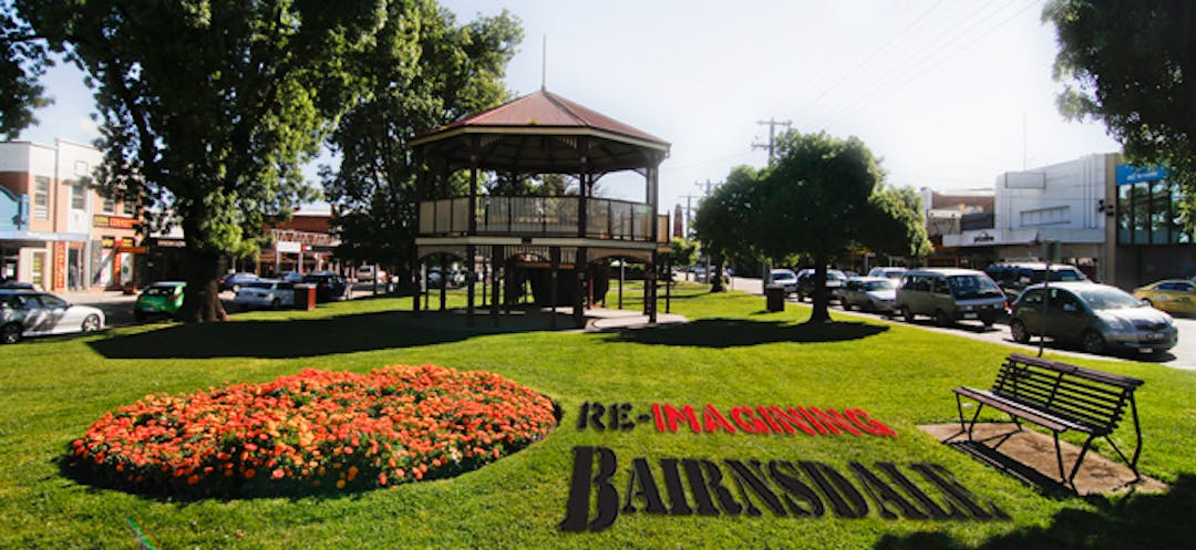 An image of Main Street gardens with the title 'Re-imagining Bairnsdale' overlaid