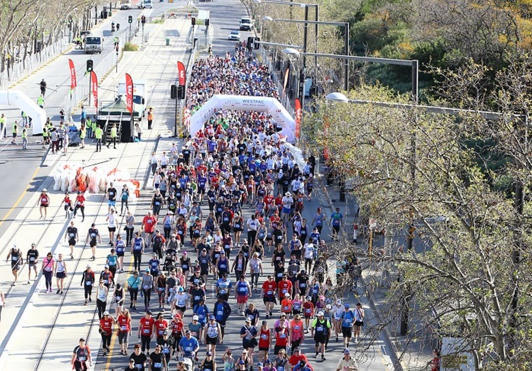 Hundreds of walkers and runners moving across the start line City to Bay fun.