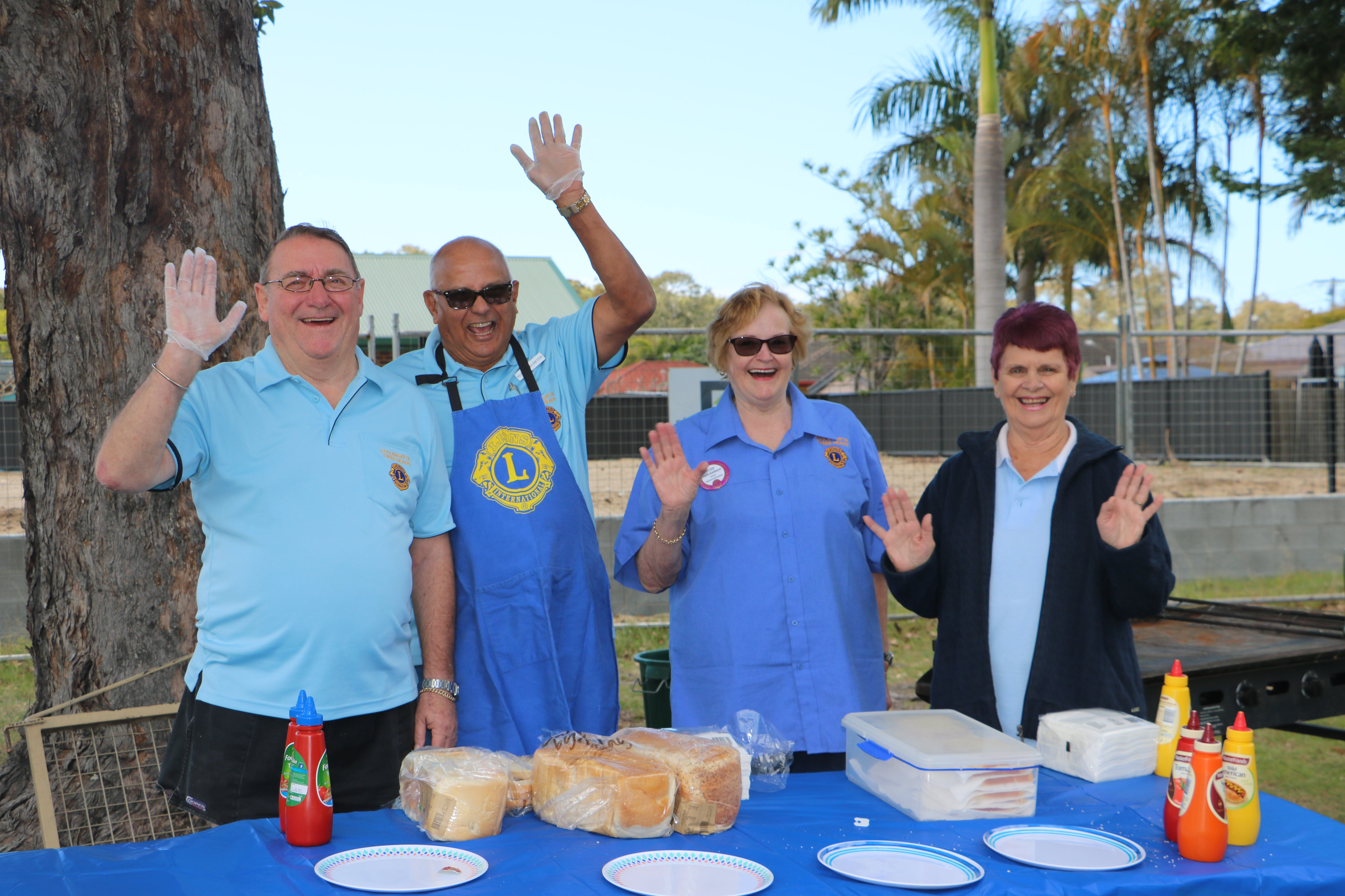 Local volunteers cooking the BBQ at the Family Fun Day.
