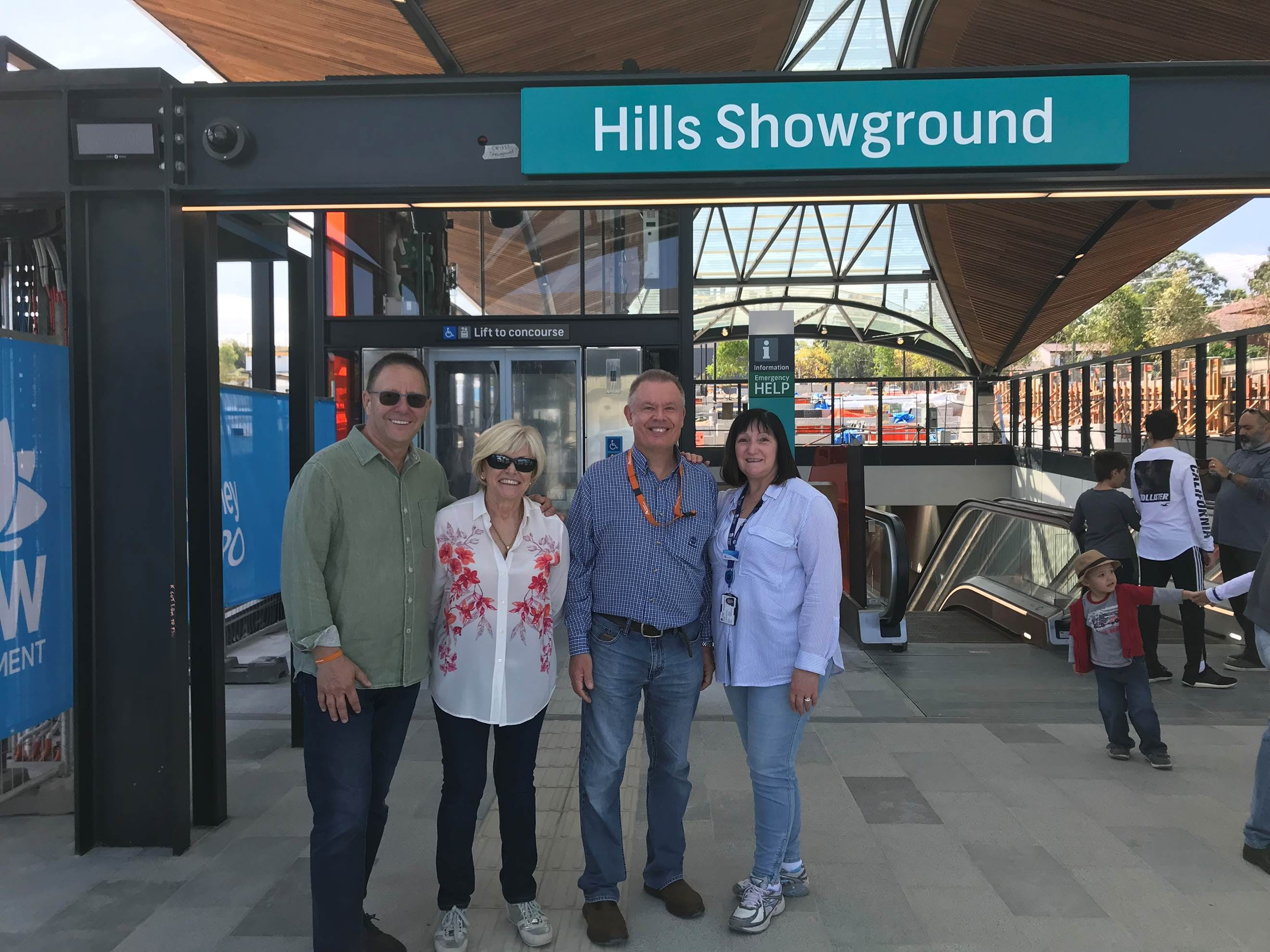 Acting Deputy Secretary, Corporate Services, Anne Hayes and her family visiting the new Hills Showground Metro station