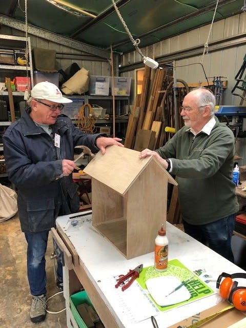 Men's Shed at work on the Street Library houses