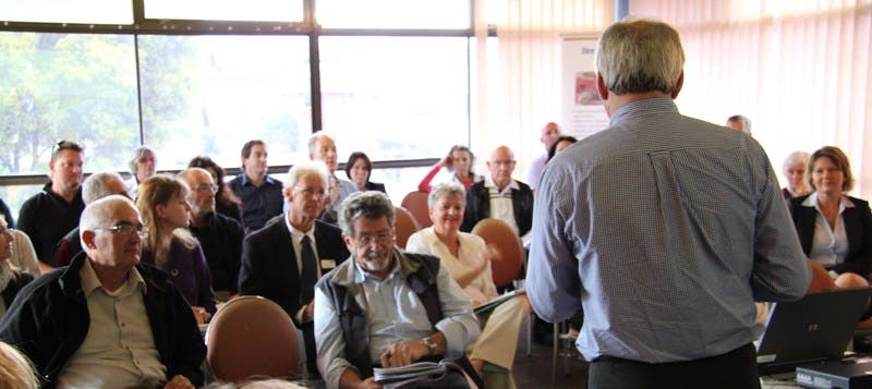 Delegates listen closely to Graham Sansom at the Murwillumbah roundtable