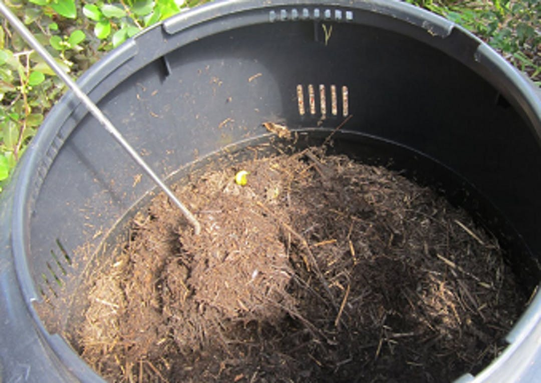 A compost turner will help aerate your compost