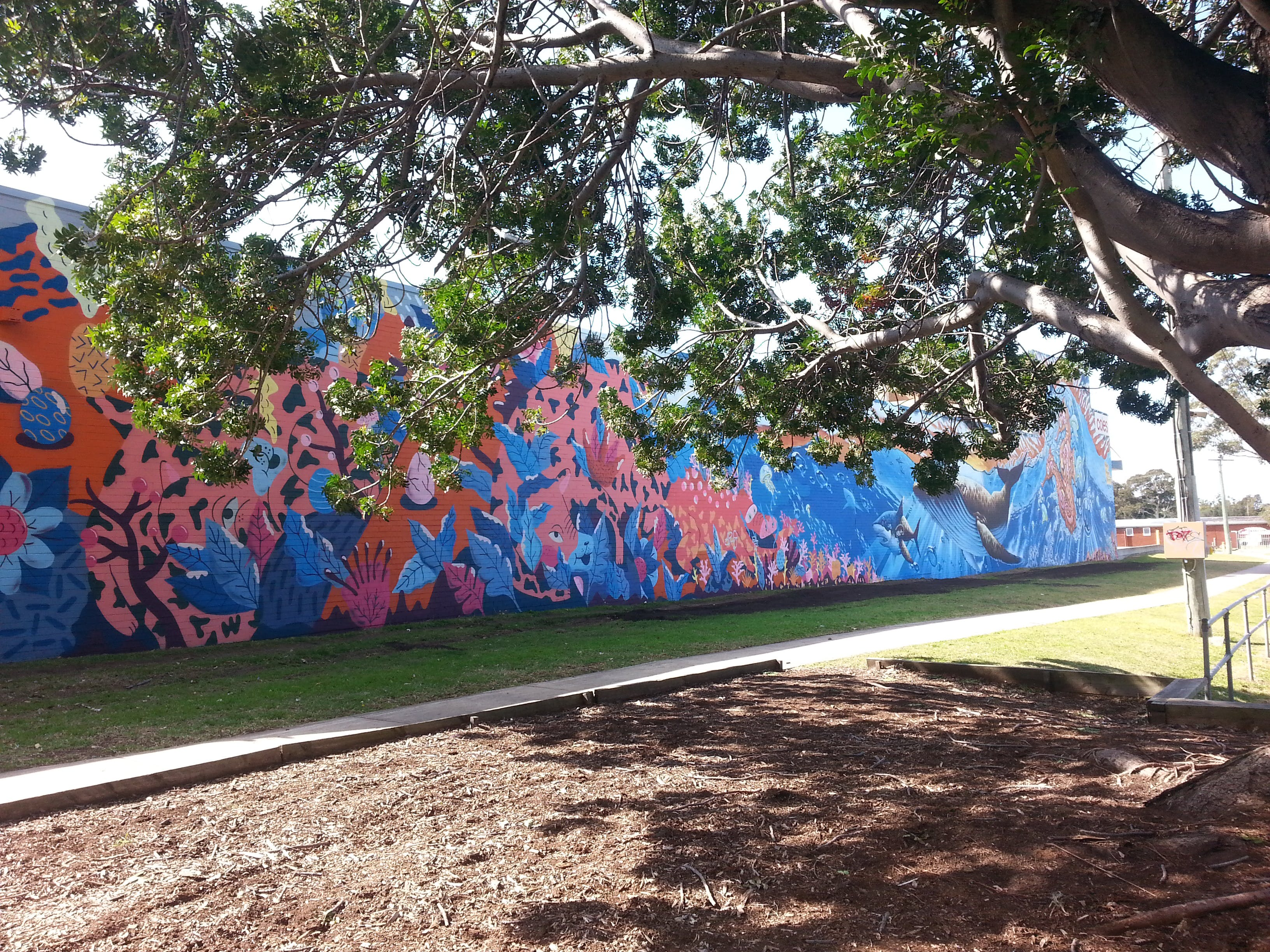 Mural peeking through the trees