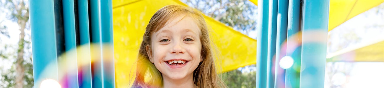 Smiling girl in a playground