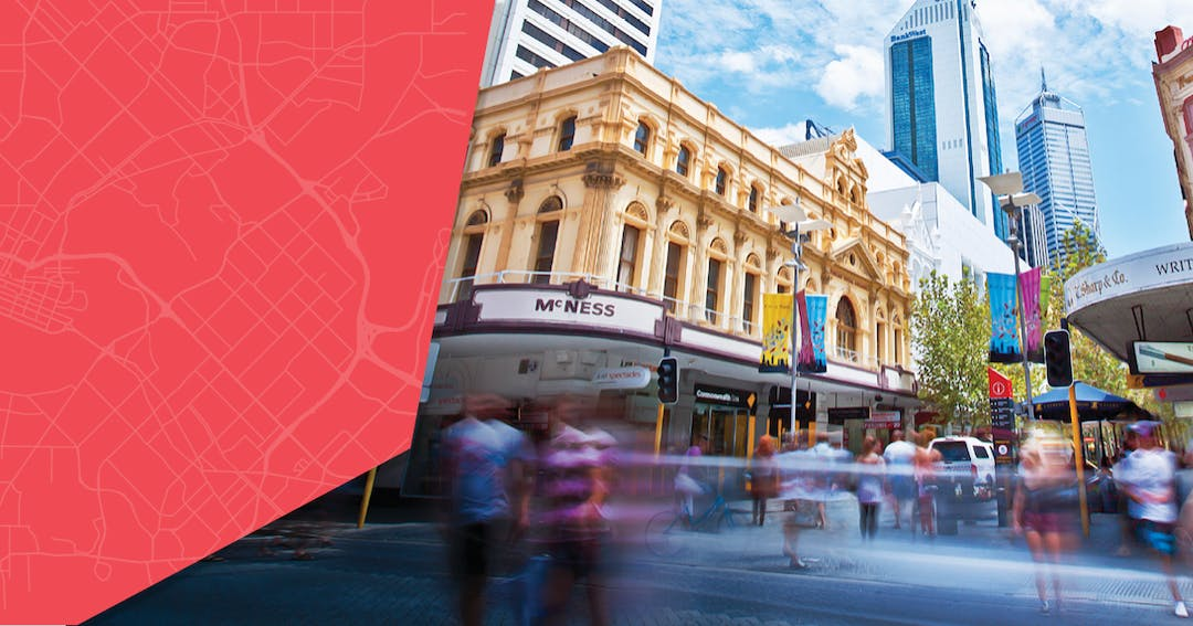 Campaign image for Perth Greater CBD Transport Plan. Photograph of pedestrians at an intersection in Perth city.