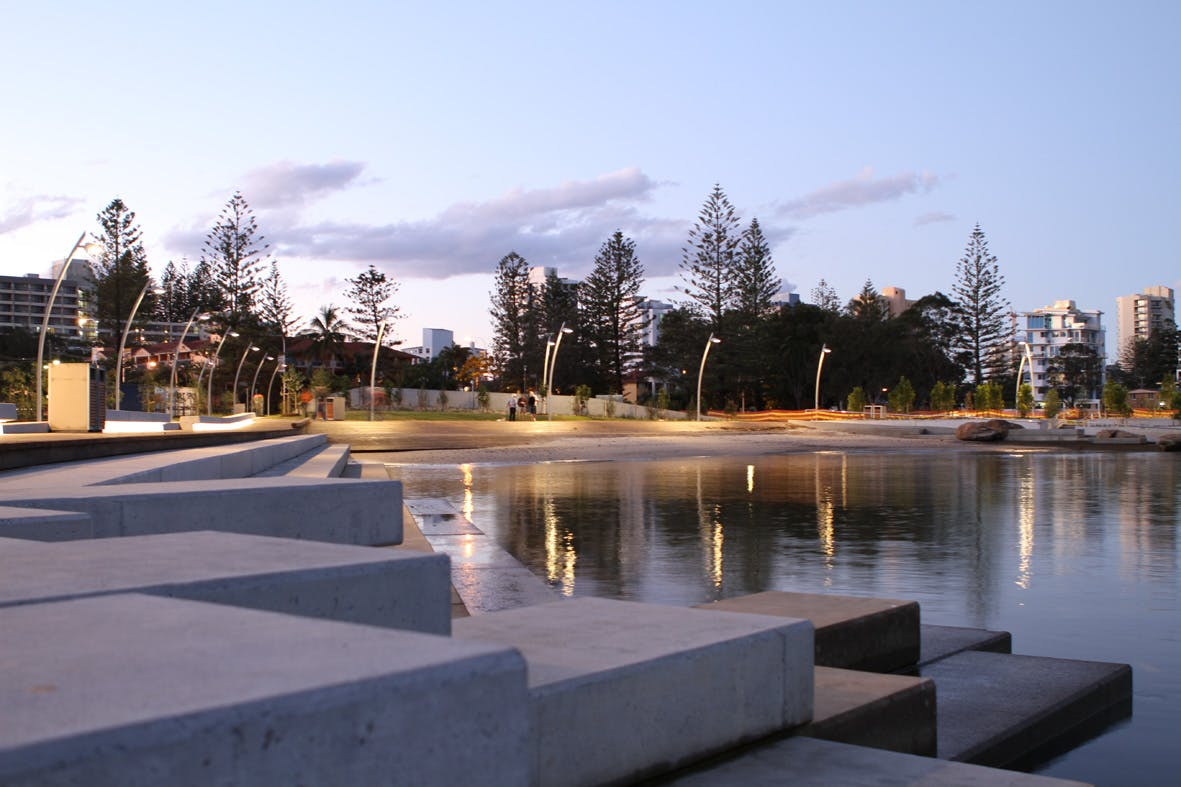 Revitalisation works overlooking calm waters at twilight
