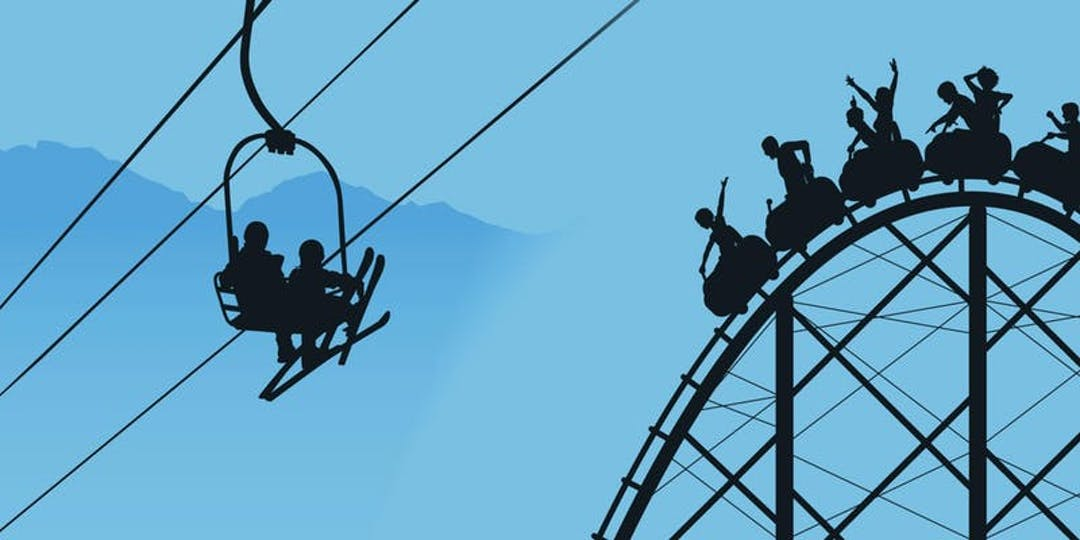 Image of ski lift going over a roller coaster