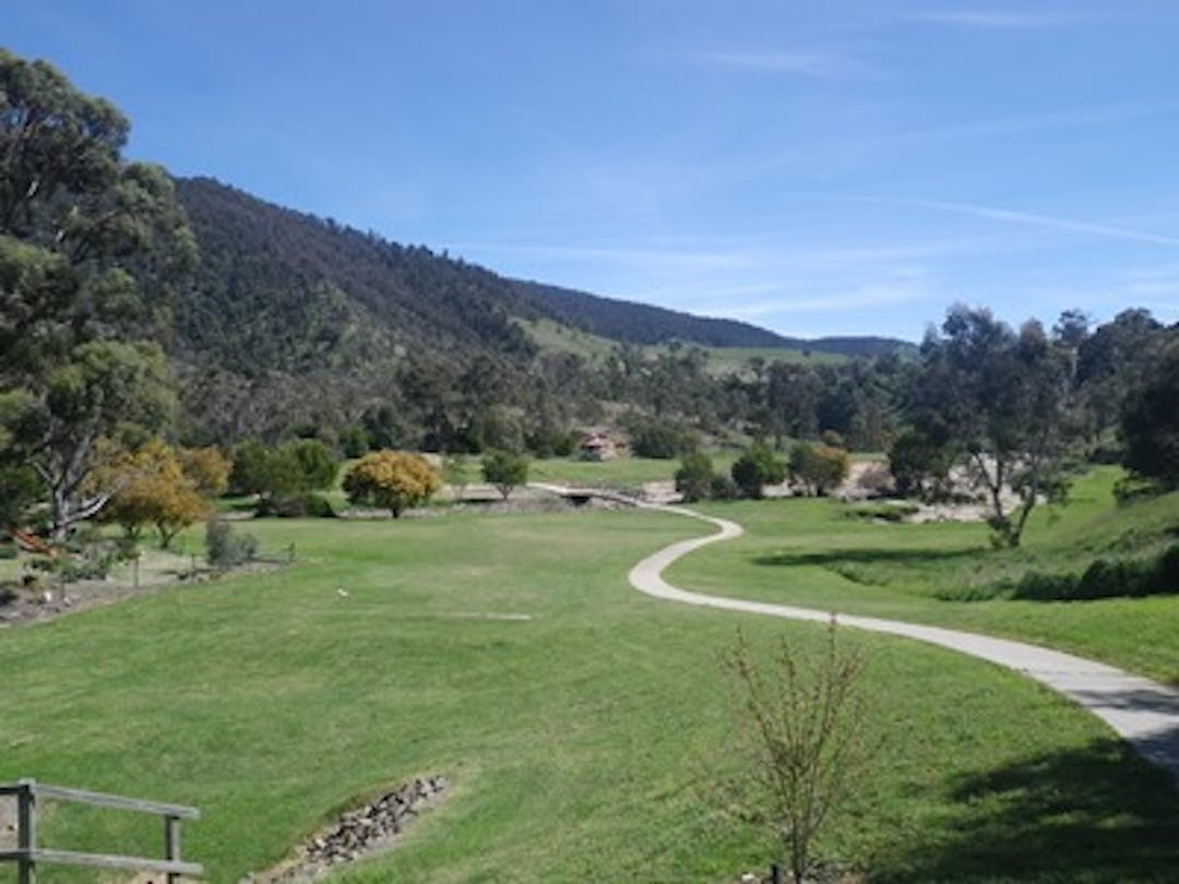An image of Livingstone Park Omeo, looking along the footpath toward the hills.