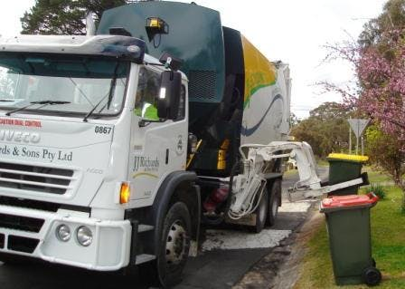 Trucks collecting recycling