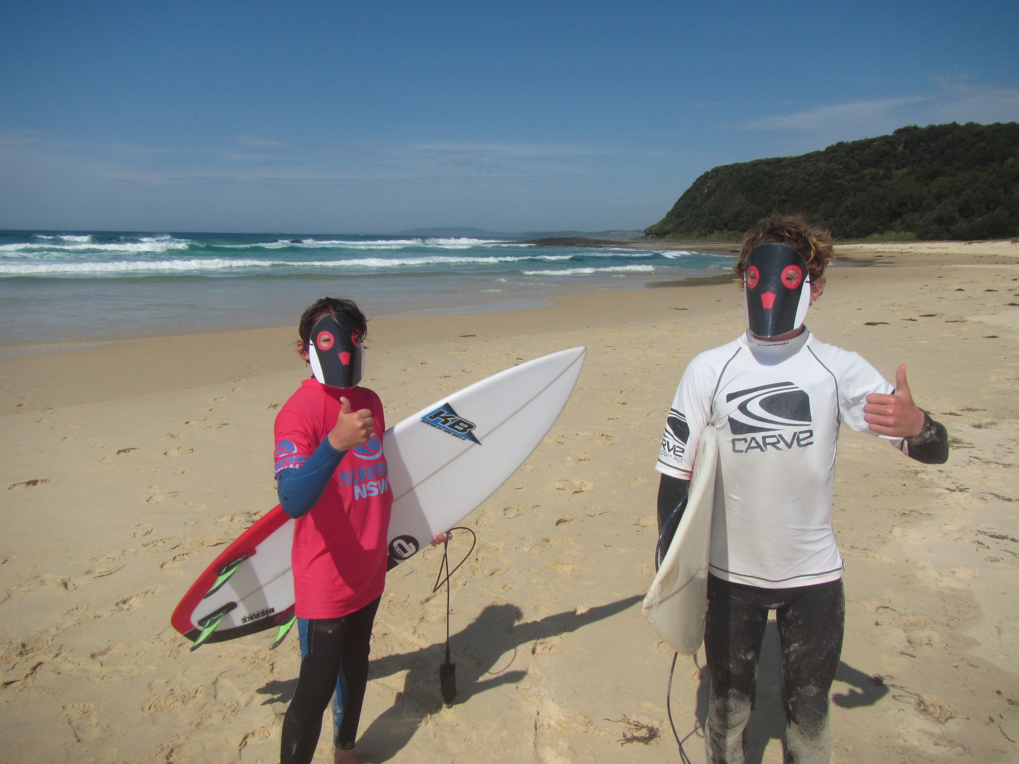 South coast local surfers give thumbs up to beach nesting bird conservation. Photo: S. Tedder , OEH.