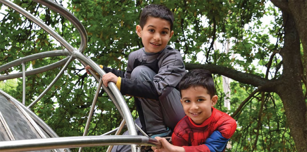 Two young boys on play equipment