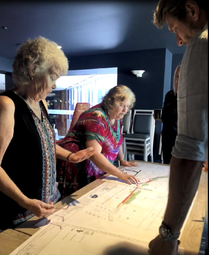 Discussing the preliminary design at the community drop-in session