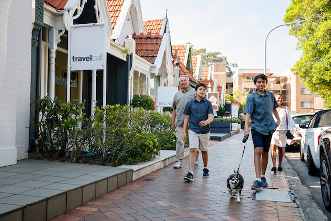 Family of four walking their dog in Double Bay
