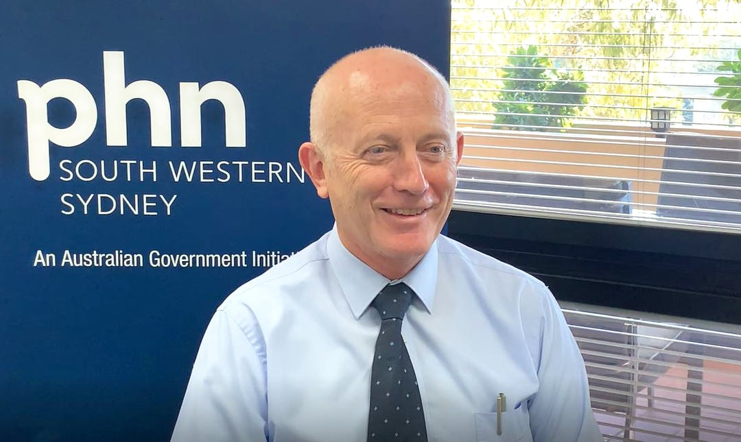 Image of South Western Sydney Primary Health Network's CEO, Keith McDonald in front of a PHN banner