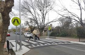 Marked pedestrian crossing on a raised platform (also known as 'Wombat crossing')