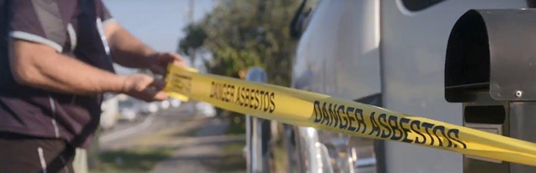 Cordoning tape with words   danger asbestos