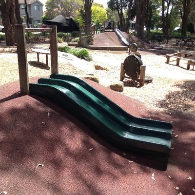 Willoughby Park Playground mound slide (musical tyre in background)