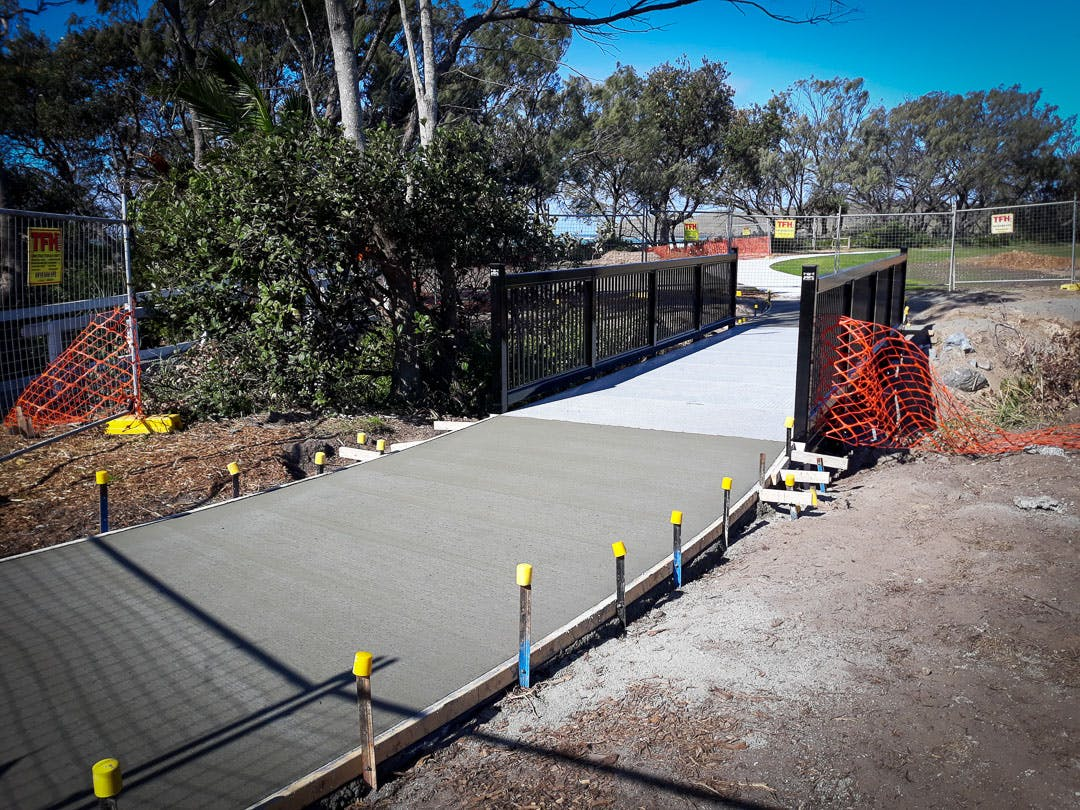The concrete links from shared pathway to the new bridge were constructed today, July 16.