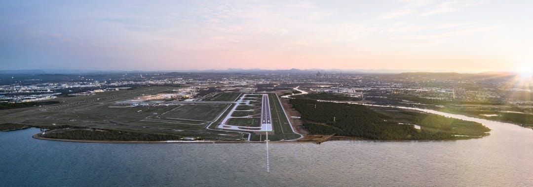 Panoramic render of the Brisbane Airport New Runway at dusk