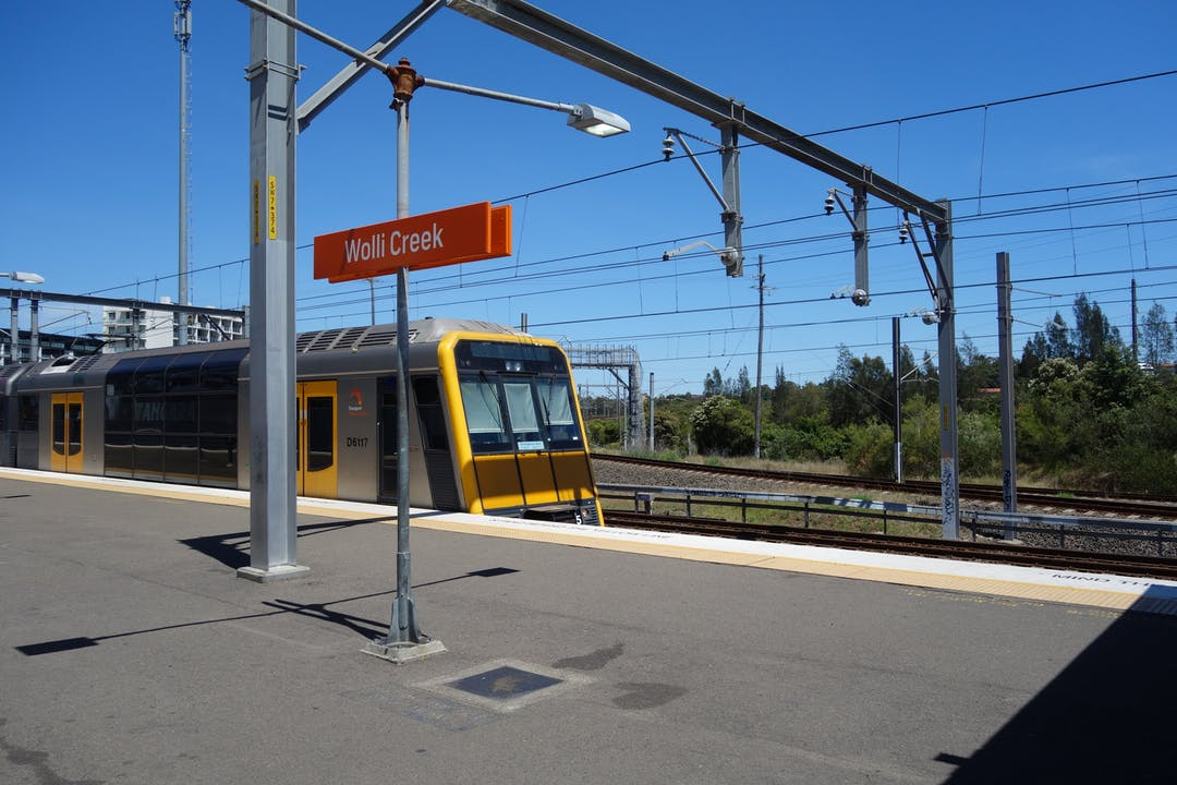 Image of Wolli Creek Station platform showing a train pulling into the station