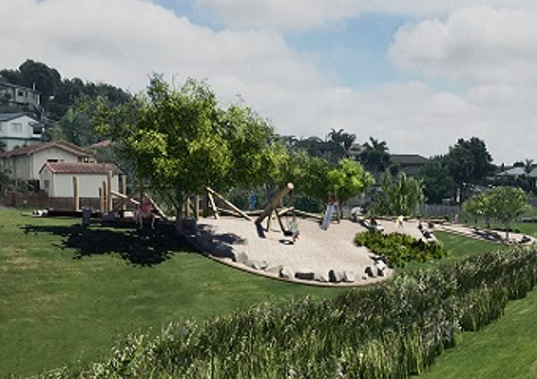 An artists 3D representation of the playground design with grass in the foreground and houses in the background. On the playground theres are swings and an slide and a see saw as well as seating and trees for shelter.