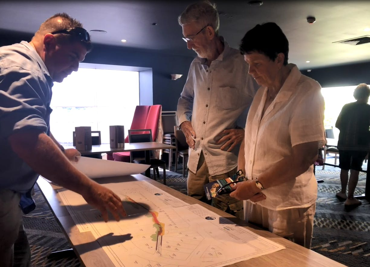 Hunter Water's project manager discusses the preliminary plan with local residents