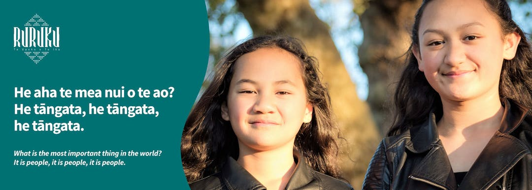 """Picture of two young tamariki with the Ruruku logo on the top left corner and the words """"He aha te mea nui o te ao? He tāngata, he tāngata, he tāngata. What is the most important thing in the world? It is people, it is people, it is people."""