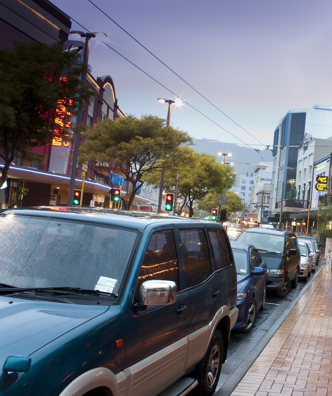 A photograph of a section of Courtenay Place, Wellington with a line of cars parked on the street.