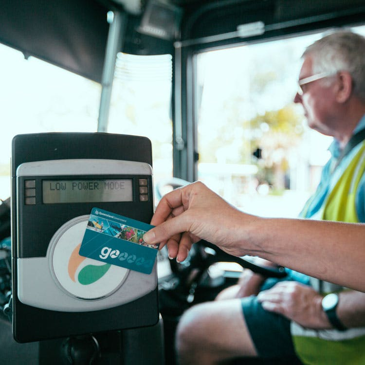 Person using a go card on a bus