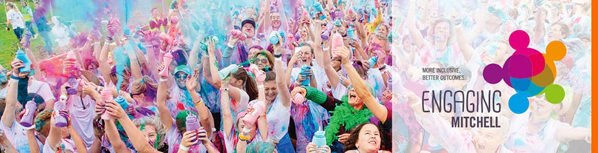 Competitors in the Colour Run with Engaging Mitchell Logo