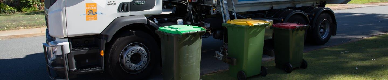 rubbish truck with bins