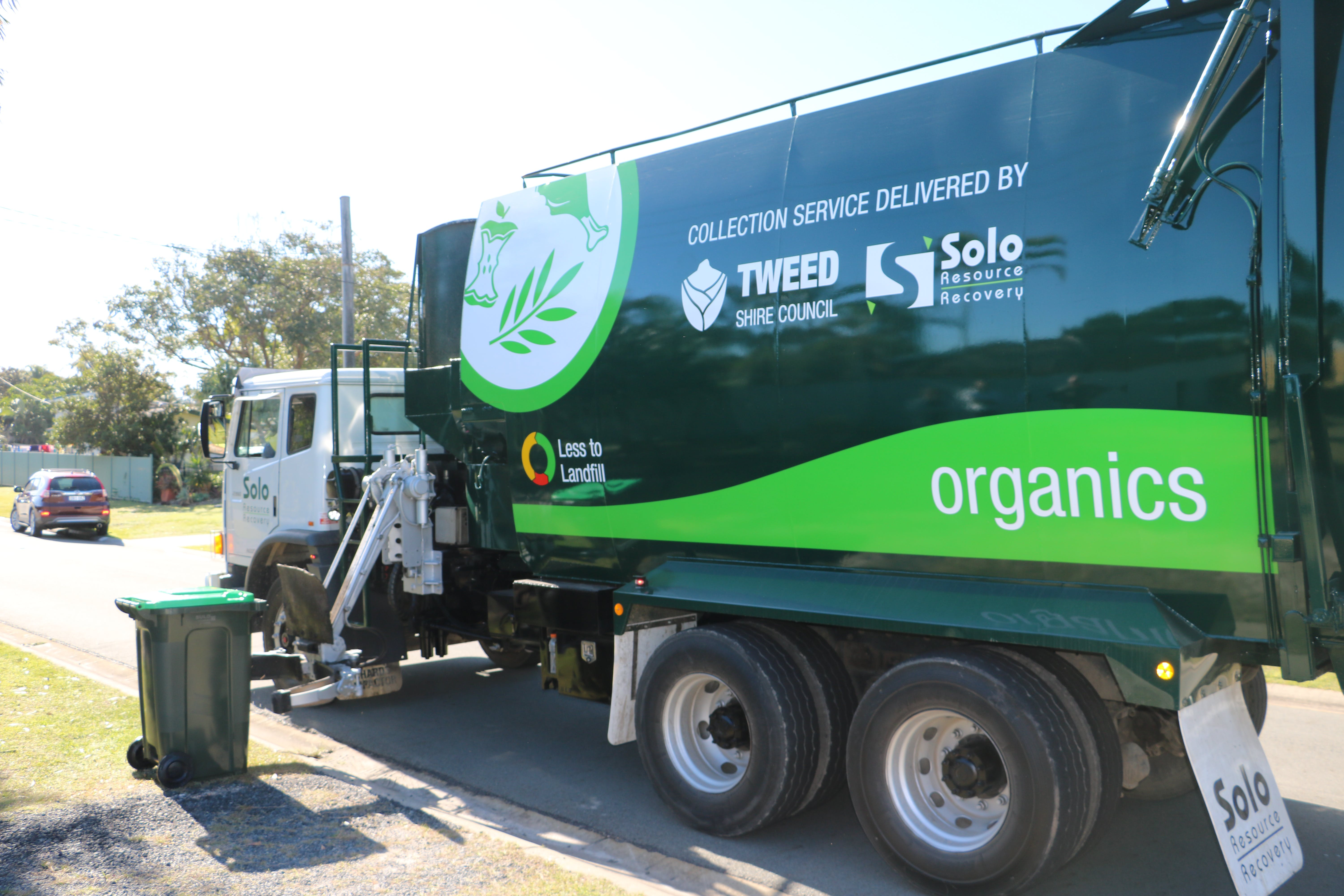 Green bin collection truck  - food scraps and garden waste are collected and reused for compost, diverting them from landfill