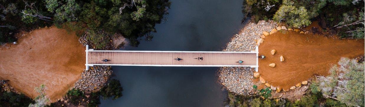 Mountain bike riders crossing the Margaret River