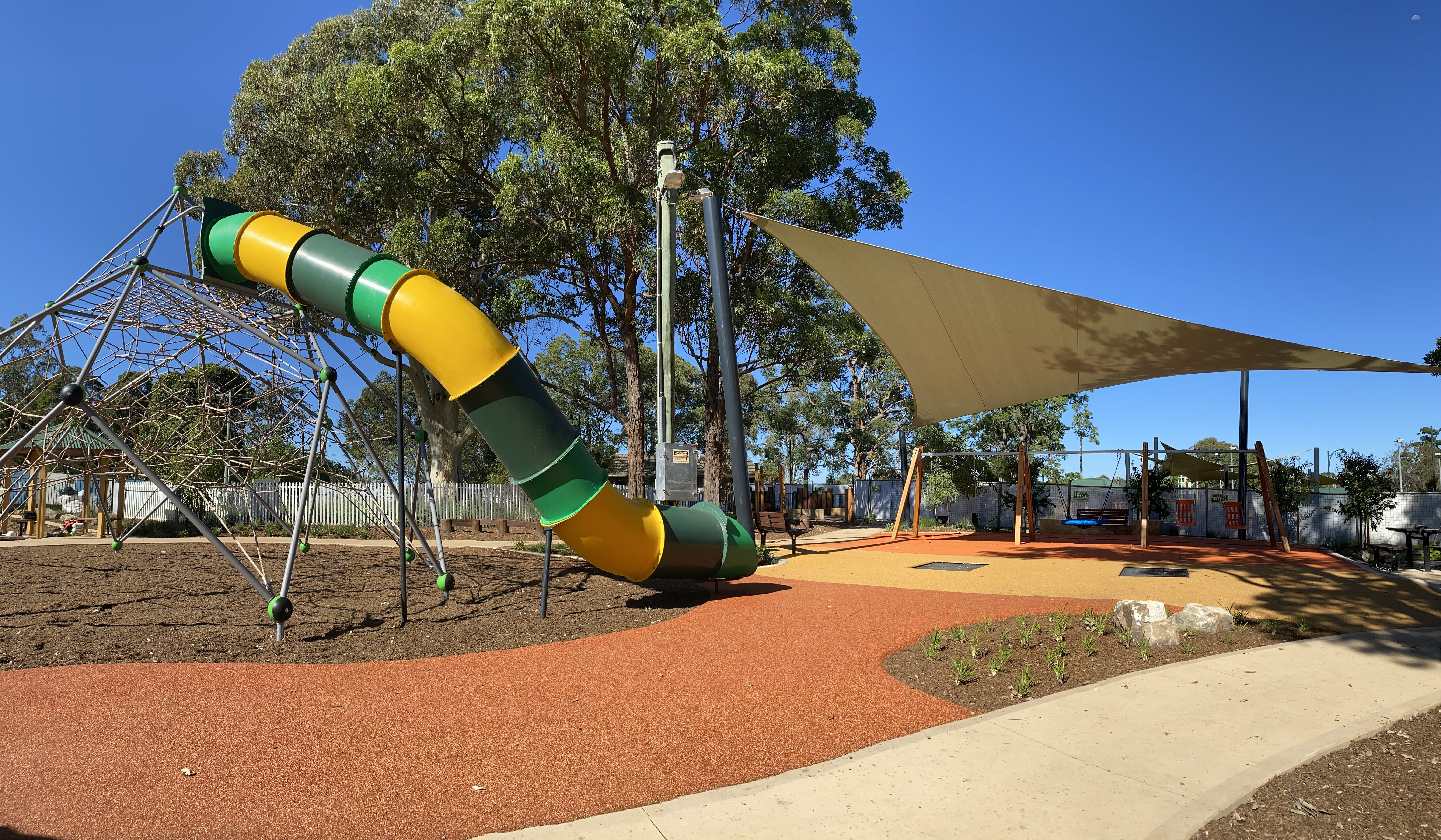 Climbing Tower and Slide with the Swings and Trampoline to the right