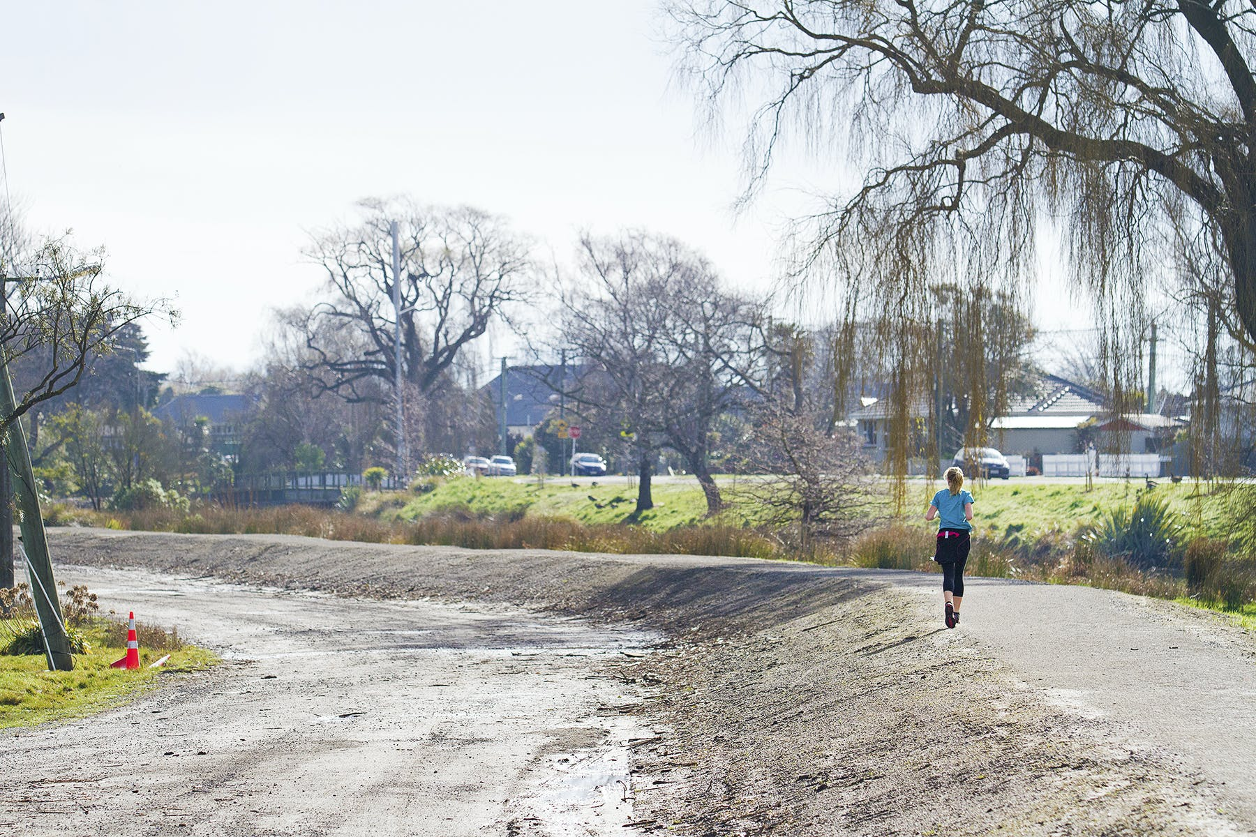 Jogger in the Ōtākaro Avon River Corridor Regeneration Area.