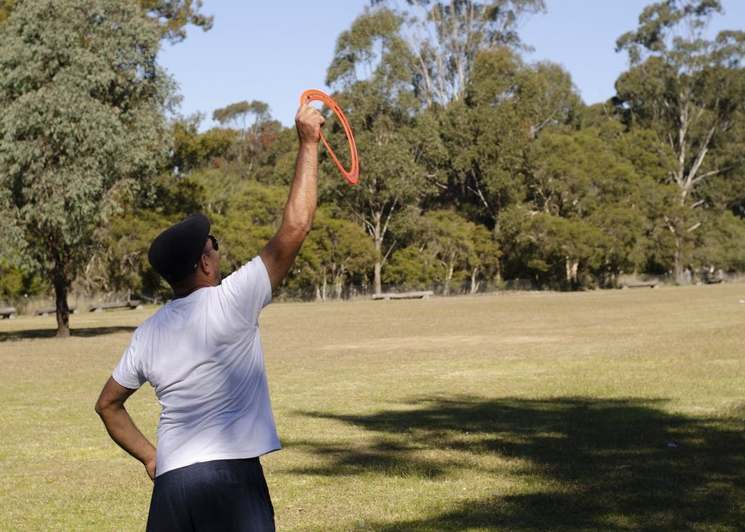 Person catching ring Frisbee in park