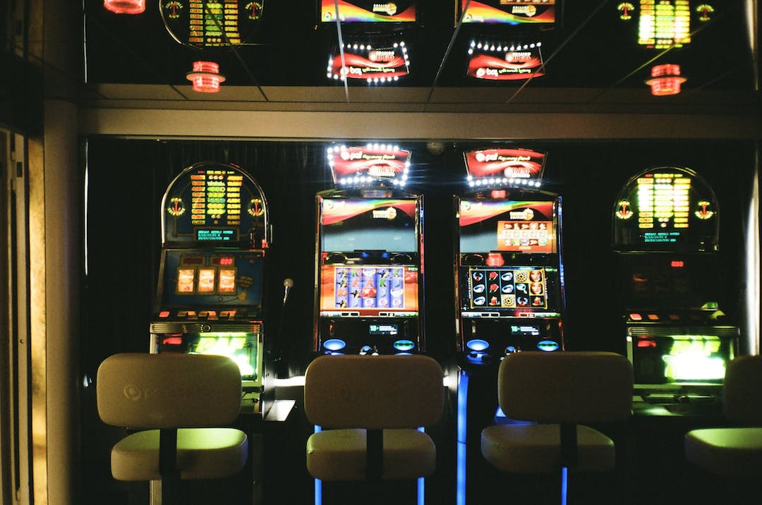 Image of a line of pokie machines in a casino