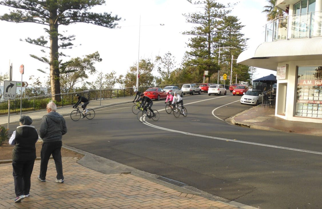 People riding bikes through the intersection