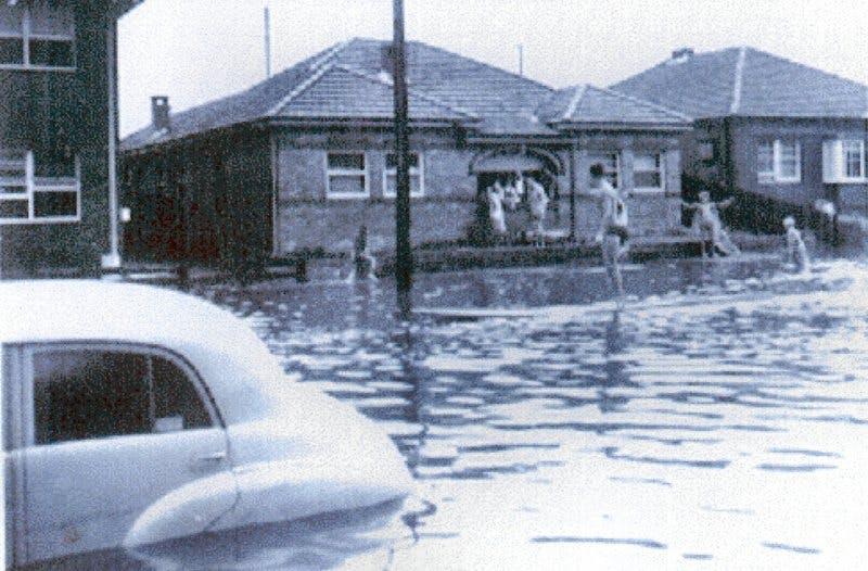 FJ Holden in Maroubra flood. 1959