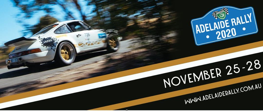 White Porsche racing in the Rally with Adelaide Rally logo.