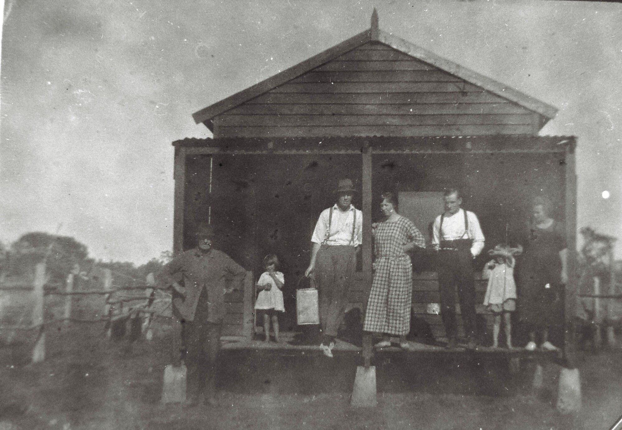 Roach family on verandah of weekender, No 28 Coon Island, 1920s. From Left Hector Ross, Hazel Ross, Arthur Roach, Rose Roach, Mr Rooke, and two members of the Rooke family.