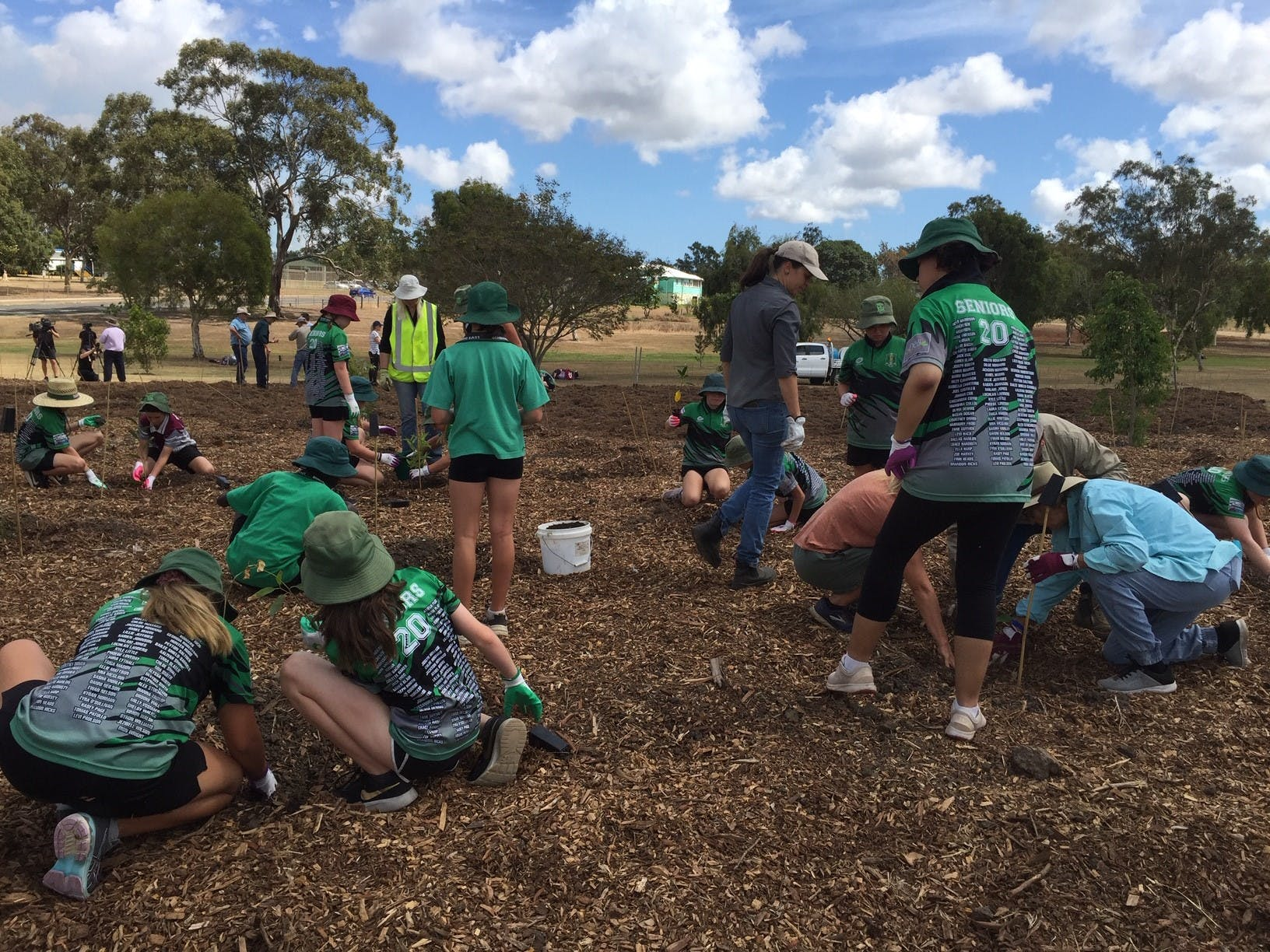 East State School students hard at work helping plant 500 trees.jpg